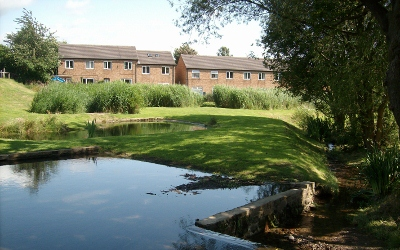 Retrofit settlement pond
