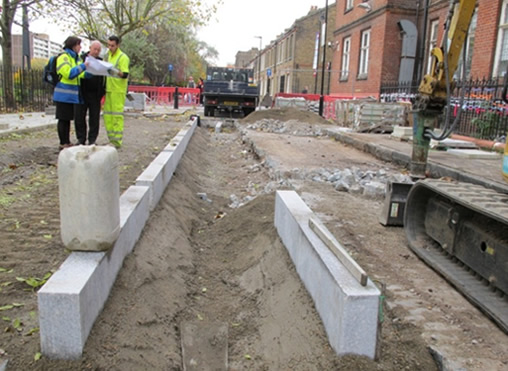 Figure 11: Lining up the rain gardens. Working back from the lowest point to attain enough fall (November 2013)